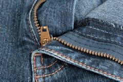 Zipper das calças de brim. Foto de Stock