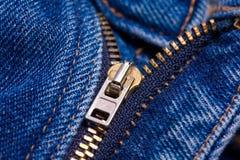 Zipper de calças de ganga imagem de stock