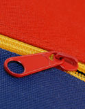 Zipper details. Details of zipper on blue and red canvas bag Royalty Free Stock Photos