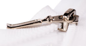 Zipper fastener. Metal and plastic zipper fastener close-up over white background stock photo