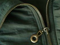 Zipper fragment. Khaki jacket fragment with metal zipper Stock Photography