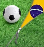 Zipper with Grass and football ball on Brazil flag. Stock Photos