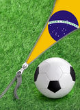 Zipper with Grass and football ball on Brazil flag. Stock Photo