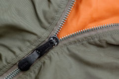 Zipper of a green jacket Stock Images