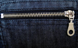 Zipper on a jeans. Silver zipper on a jeans back pocket stock images