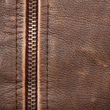 Zipper and leather. Brown leather texture and zipper background royalty free stock photography