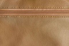Zipper with leather texture. Background Royalty Free Stock Image