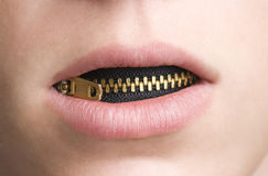 Zipper in Mouth of Youthful Person Royalty Free Stock Photos