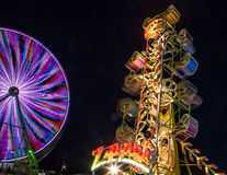 The Zipper at Night. Midway carnival at the county fair. Famous Zipper ride that is popular with teens and adults Royalty Free Stock Photo