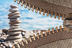Zipper with sea pebbles background. Zipper of a camping tent with sea pebbles background Stock Images