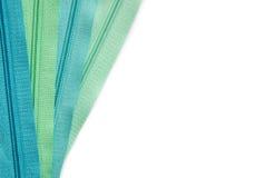 Zipper set isolated on white background. Clothing zipper pastel green and blue set isolated on white background stock image