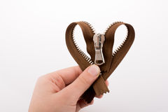 Zipper in the shape of a heart Royalty Free Stock Photo