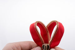 Zipper in the shape of a heart Stock Images