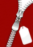 Zipper with tag. Silver zipper with blank tag over red fabric Royalty Free Stock Photo