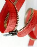 Zipper vermelho em um branco Imagens de Stock Royalty Free