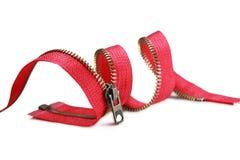 Zipper vermelho em um fundo branco Imagens de Stock Royalty Free