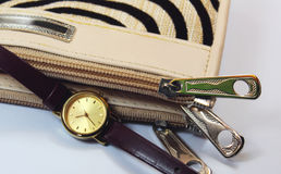 Zipper of wallet with watch Royalty Free Stock Image