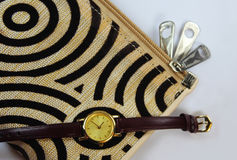 Zipper of wallet with watch Stock Images