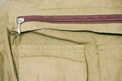 Zippered Pocket. A section of a vest showing the zipper on the pocket Royalty Free Stock Image