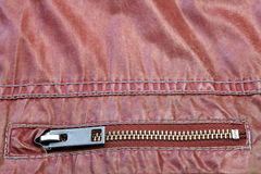 Zippered Red Leather Pocket Close-up. Zippered Red Leather Pocket With Metal Fastener, Close-up Royalty Free Stock Image