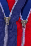 Zippers. Red & blue zippers Royalty Free Stock Photography