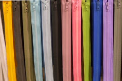 Zippers assorted colors. Parallel zippers assorted different colors stock photos