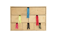 Zippers coming out. A wooden case filing with six colors zippers Royalty Free Stock Images