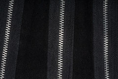 Zippers on fabric Stock Images
