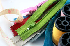 Zippers with sewing accessories Royalty Free Stock Images