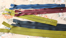 Zippers for sewing. Black, green and blue zippers for sewing royalty free stock photos
