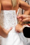 Zipping up brides dress. A moms hands zipping up the brides dress Royalty Free Stock Photography