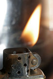 Zippo. Really great macro photo of a zippo lighter. Sharp close-up and stunning flame Royalty Free Stock Images