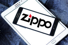 Zippo company logo. Logo of zippo company on samsung mobile on samsung tablet. A Zippo lighter is a reusable metal lighter manufactured by American Zippo Royalty Free Stock Photos