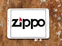 Zippo company logo. Logo of zippo company on samsung tablet on wooden background. A Zippo lighter is a reusable metal lighter manufactured by American Zippo Stock Photos