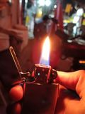 Light my fire. Zippo US Original. Zippo flare blurry vision Royalty Free Stock Image