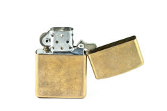Zippo lighter. Brass metal zippo lighter isolated on white background Royalty Free Stock Image