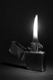 Zippo Lighter. Dramatic picture of zippo lighter on black background Royalty Free Stock Images