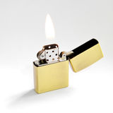 Zippo Lighter with Flame Stock Photo