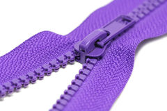 Zips for clothes purple color Royalty Free Stock Photos