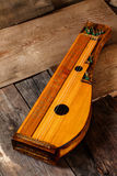 Zither - ancient folk instruments. Ancient stringed folk instrument made of wood Stock Photography