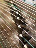 Zither,Gu Zheng. Strings and bridges of Chinese ancient instrument Gu Zheng Royalty Free Stock Photo
