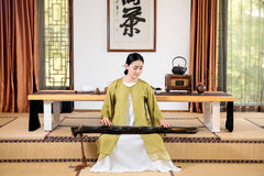 Zither performance-China tea ceremony Royalty Free Stock Photography