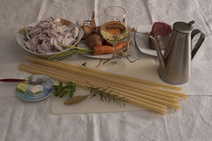 Ziti (Long pasta of durum wheat) Genoese ingredients royalty free stock photos