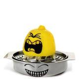 Zitrone, die mit gemaltem schreiendem Gefühl zusammendrückt Stockbilder