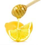 Zitrone mit Honig Stockfotografie