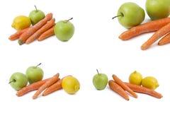 Zitrone mit Karotte und grünem Apfel auf einem weißen Hintergrund Früchte auf einem weißen Hintergrund Grüne Äpfel und Karotten Z Stockfotos