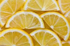 Zitronenscheibenhintergrund stockfotografie