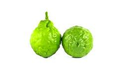Zitrusfrucht auf dem weißen Hintergrund Stockfotos