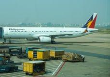Zivilflugzeuge, die an Tan Son Nhat International-Flughafen parken Lizenzfreie Stockfotos