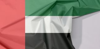 Zjednoczone Emiraty Arabskie tkaniny flaga zagniecenie z biel przestrzenią i krepa obrazy stock